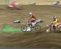 Jeffrey Herlings fights his way through the pack to pass Dungey for the win in the SMX Cup